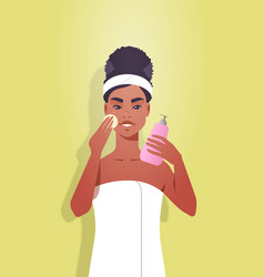 Young woman applying foundation cream dressed vector