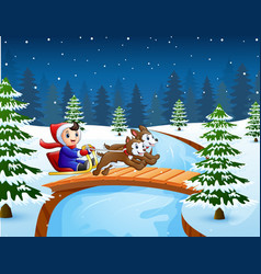 Cartoon boy riding sled on the bridge in the snowi vector