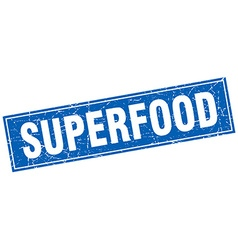 Superfood blue square grunge stamp on white vector