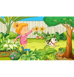 Girl playing with dog in the garden vector image