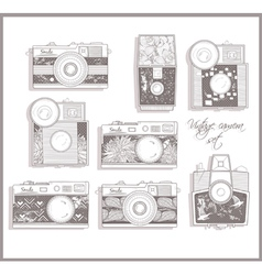 retro photo cameras set with floral pattern vector image