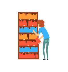 young man choosing books in bookstore cartoon vector image