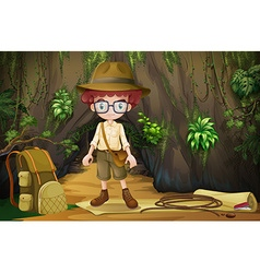 Boy camping out in the cave vector image vector image
