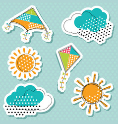 Sun with clouds and flying kites sticker vector