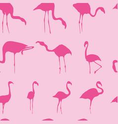 Silhouette flamingos seamless pattern vector