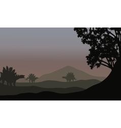Silhouette of stegosaurus in fields vector
