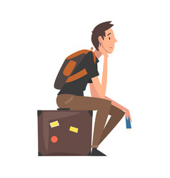 man sitting on suitcase waiting for departure guy vector image