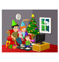 a happy family watching television in christmas vector image