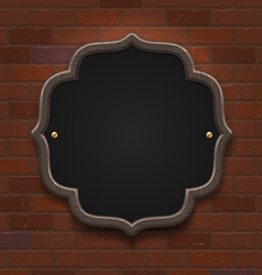 Chalkboard in wooden frame on vintage brick wall vector image