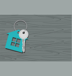 key with symbol of house key on wooden background vector image