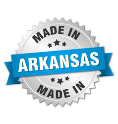 Made in arkansas silver badge with blue ribbon vector