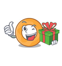 With gift onion ring mascot cartoon vector