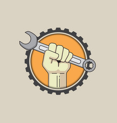 fist with wrench on gear background vector image