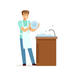 Young smiling man washing dishes in kitchen vector