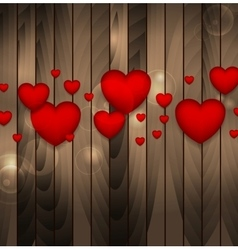 Red hearts on brown wooden background vector