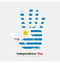 Handprint with the Flag of Uruguay in grunge style vector