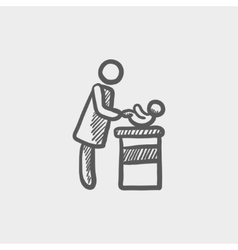 Woman changing the babys diaper sketch icon vector image