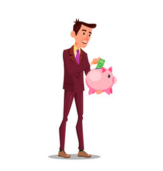 happy businessman putting money in the piggy bank vector image
