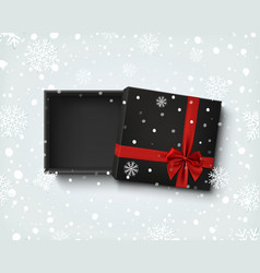 Opened black empty gift box with red ribbon and vector