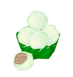 Thai Stuffed Coconut Ball in Counts Banana Leaf vector