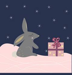 cute rabbit with a present vector image