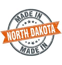 North Dakota orange grunge ribbon stamp on white vector