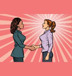 Two businesswomen shaking hands vector