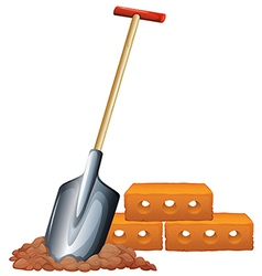 A shovel and bricks vector