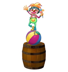 A playful clown above the wooden barrel vector image vector image