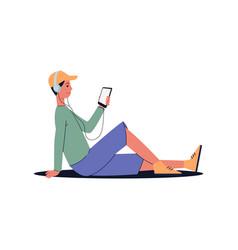 man sitting on floor with headphones listening vector image