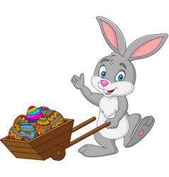 cartoon rabbit pushing cart full of easter eggs vector image