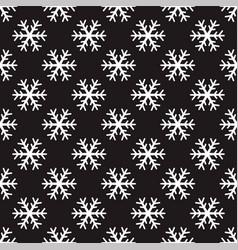 White snowflakes on black background vector