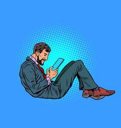 a man reads an electronic tablet vector image