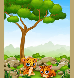 Cartoon baby cheetah with kitten lay down in the j vector
