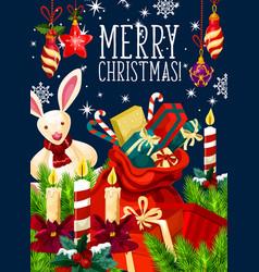 Santa gift bag with christmas candle greeting card vector