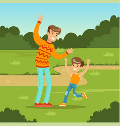 happy young family and son playing games in city vector image vector image