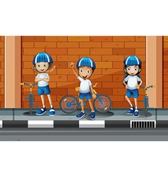 Children riding bicycle on the road vector image
