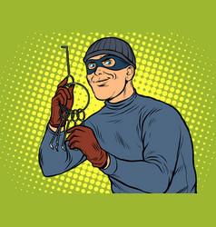 Thief with a bunch lockpick keys vector