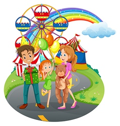 A family at the amusement park vector image