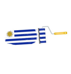 Brush stroke with uruguay national flag isolated vector