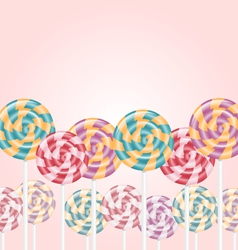 Multicolored lollipops on pink vector