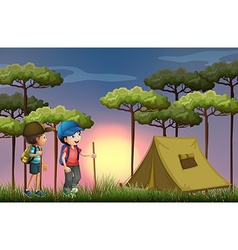 Two boys hiking and camping in the forest vector image