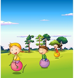 Three kids playing with the bouncing balls vector image vector image