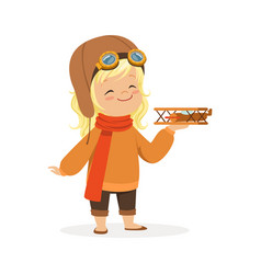 Cute little girl in pilot costume playing with toy vector