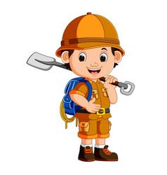cute hiker boy holding shovel vector image