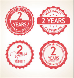 Two years warranty retro vintage badge and labels vector