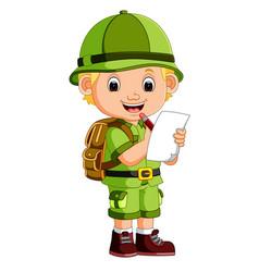 Cute hiker boy holding paper vector