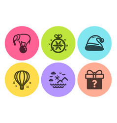 Santa hat air balloon and elephant on ball icons vector