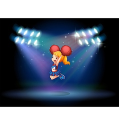 A cheerleader jumping in the middle of the stage vector image vector image