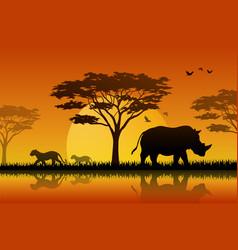 Silhouette of rhino at lake in savanah vector